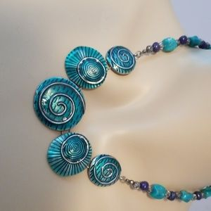 "Turquoise colored""shell"" necklace."